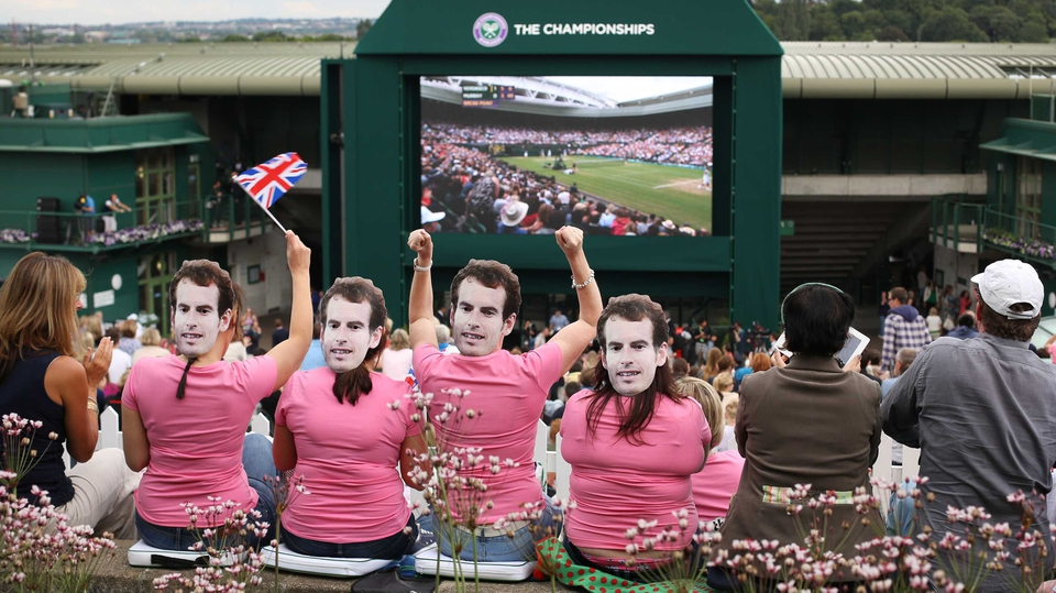 Andy Murray fans cheer on the Scot as he became the first British player to win the men's Wimbledon title in 76 years