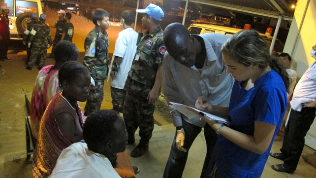A UNMISS medical team assists civilians at the Cambodian-run hospital in the UNMISS compound in Juba