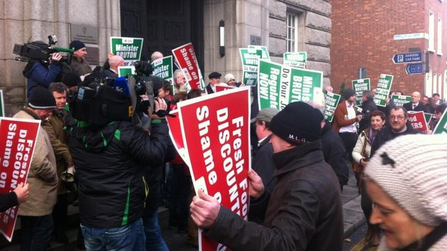 Around 200 farmers earlier protested outside the offices of Minister for Enterprise Richard Bruton