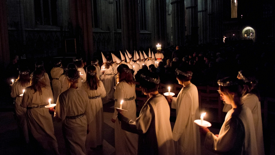 The Sankta Lucia festival of light procession during a service at York Minster in England