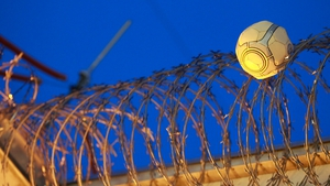 A football stuck in barbed wire inside the Borgo prison centre on the French island of Corsica