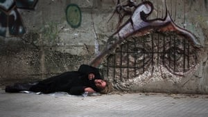 A homeless woman sleeps on a street in the Lebanese capital Beirut