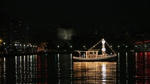 A traditional Christmas boat decorated with lights is docked in the Thermaic Gulf off the shores of the Greek city of Thessaloniki