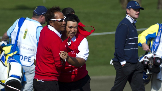 Thongchai Jaidee and Kiradech Aphibarnrat celebrate their win over Stephen Gallacher and Paul Lawrie