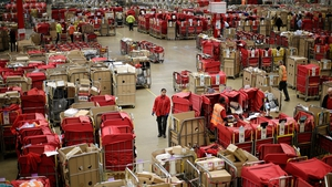 Workers process the Christmas rush at the packet and parcel section of the Royal Mail's Swan Valley mail centre in Northampton, England
