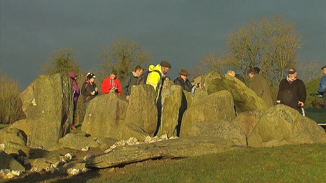 A group gathered at the Knockroe passage tomb in Co Kilkenny for the Winter Solstice