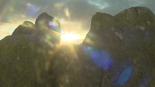 Sunlight breaks through at Knockroe  passage tomb in Co Kilkenny on the day of the Winter Solstice