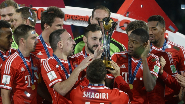 Bayern Munich's stars get to grips with their latest trophy