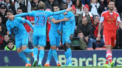 Goal scorer Emmanuel Adebayor is congratulated by his Spurs team-mates