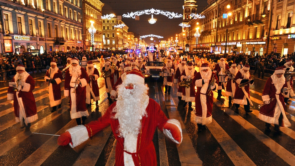 Musicians wearing Santa Claus costumes march along Nevsky Prospect during a New Year's Eve festival parade in central St Petersburg