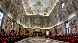 Pope Francis speaks during the audience of the Curia, the administrative apparatus of the Holy See, for Christmas greetings in the Sala Clementina of the Apostolic Palace at the Vatican