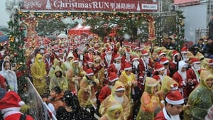 Runners dressed up as Santa Claus take part in a Christmas Run in Taipei