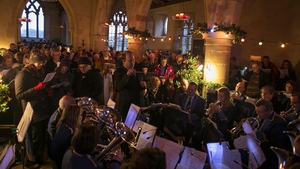 The Bratton Silver Band performs as people sing Christmas carols inside the 13th century St Giles church in the village of Imber in England. Imber was evacuated for military training in WWII, and villagers have never been allowed to return