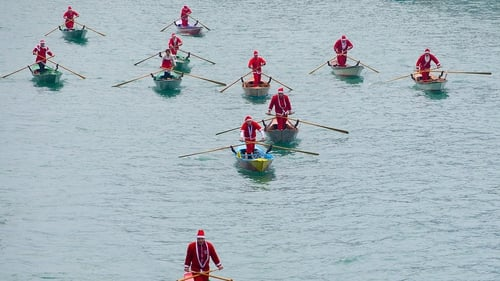Rowers dressed as Santa take part in the Christmas Regatta on the Grand Canal in Venice, Italy