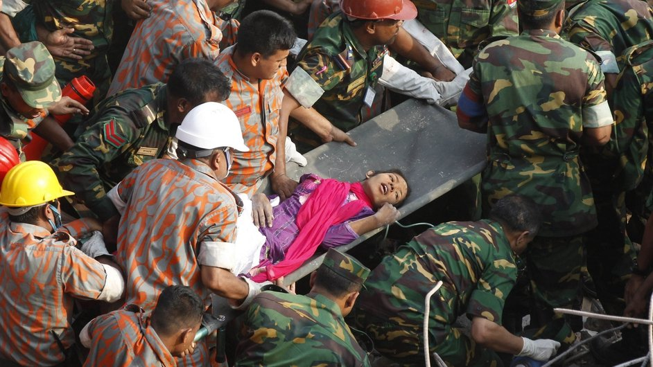 Bangladeshi rescuers retrieve garment worker Reshma from the rubble of a collapsed building in Savar, 17 days after the eight-storey building collapsed