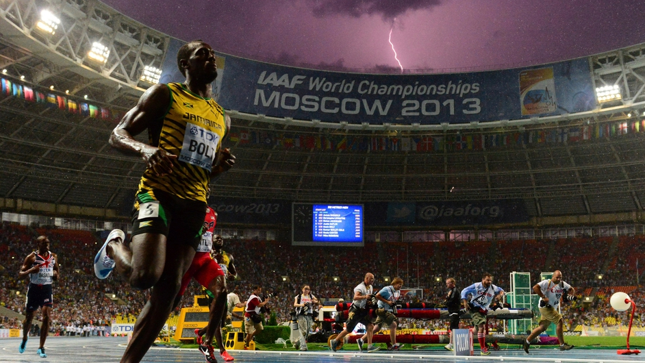 Jamaica's Usain Bolt wins the 100 metres final at the World Championships in Moscow as lightning strikes in the sky
