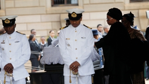 Nelson Mandela's widow Graca Machel touches the coffin of the former South African President as he lies in state in Pretoria