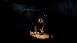 A Palestinian cleans a smuggling tunnel in Gaza after Egyptian authorities pumped wastewater into the tunnels