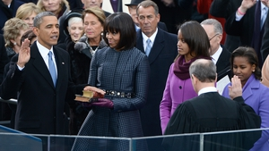 US President Barack Obama places his hand on a bible held by his wife as he is ceremonially sworn in for a second term by Chief Justice John Roberts