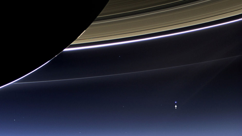 NASA's Cassini spacecraft captures Saturn's rings and Earth (annotated by arrow) in the same frame