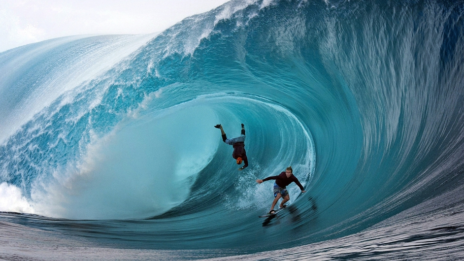 Garrett McNamara and Mark Healey compete during a free session of a surfing tournament in Tahiti