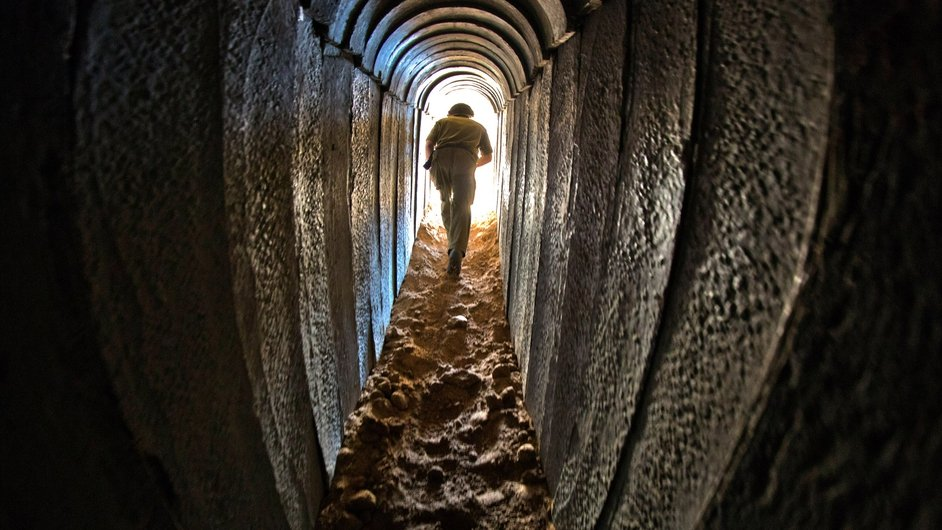 An Israeli soldier walks out from a tunnel the Israeli army discovered near Kissufum