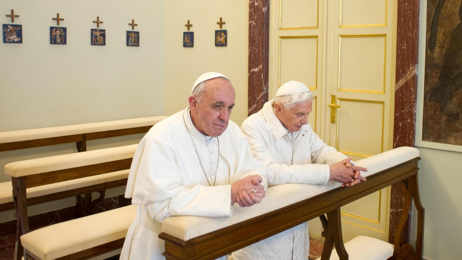 Pope Francis prays with Pope Emeritus Benedict XVI during a meeting in Castel Gandolfo outside Rome