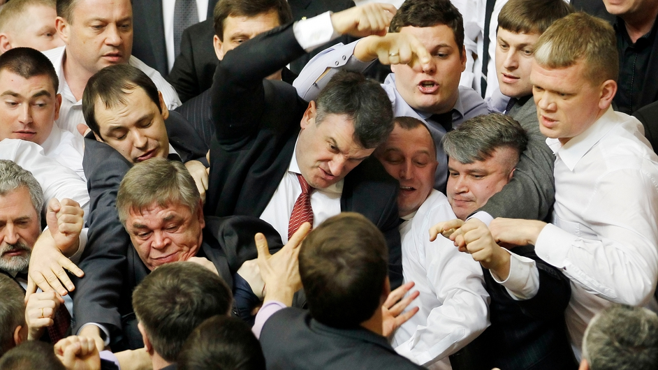 Ukrainian politicians exchange blows in parliament during a debate on languages