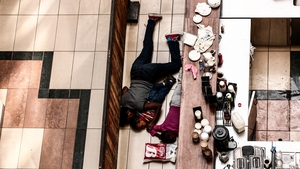 People take cover behind a counter during an armed siege at the Westgate shopping centre in Nairobi