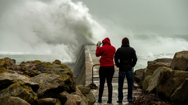 Big waves crash against a break-water pier during a storm in Esquibien, in the western region of Brittany, France