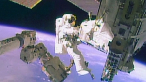 Two NASA astronauts spent more than seven hours working outside the International Space Station (pic: NASA TV)