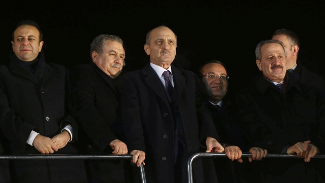 Erdogan Bayraktar (centre) urged the prime minister to stand down
