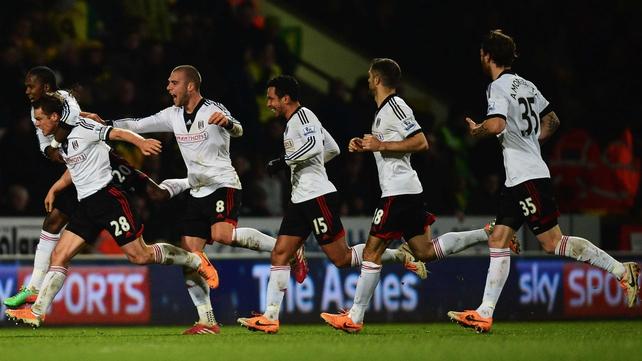 Fulham celebrate Scott Parker's winner