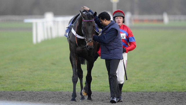 Barry Geraghty with Sprinter Sacre after pulling up in The williamhill.com Desert Orchid Steeple Chase