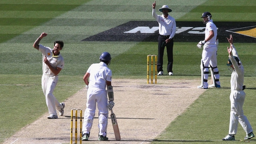 Mitchell Johnson takes the wicket of Monty Panesar