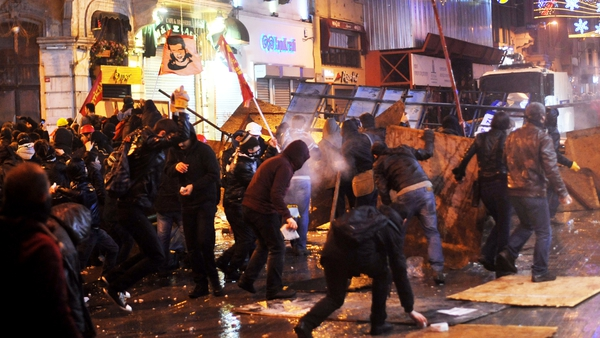 Protesters calling for the resignation of Turkish Prime Minister Tayyip Erdogan clash with riot police in Istanbul