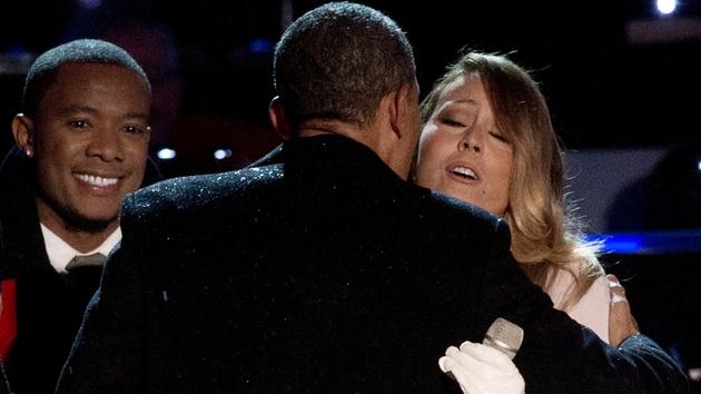 US President Barack Obama greets singer Mariah Carey during the National Christmas Tree Lighting ceremony near the White House in Washington.