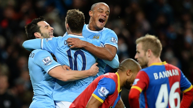 Edin Dzeko (No 10) celebrates what proved to be the winning goal with  Alvaro Negredo (left) and Vincent Kompany (right)