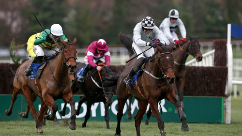 Tony McCoy drives Carlingford Lough (l) in the final stages of the Topaz Novice Chase