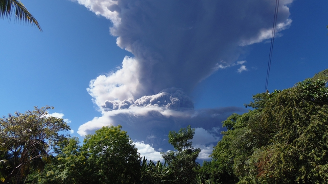 View of the Chaparrastique volcano spewing ashes and smoke in San Miguel