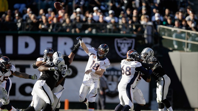 Denver Broncos quarterback Peyton Manning throws his third touchdown pass of the game against the Oakland Raiders