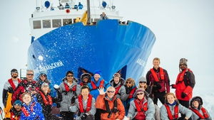 Passengers pictured in front of the Akademik Shokalskiy ship