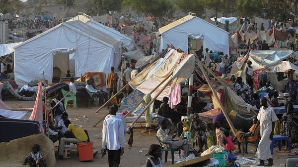 South Sudanese continue to flock to a makeshift camp as fears over fighting fester