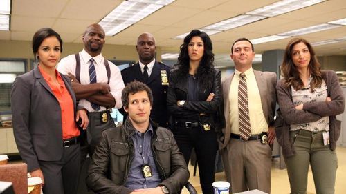 Andy Samberg (seated) stars as an infantile cop in new US comedy Brooklyn Nine-Nine