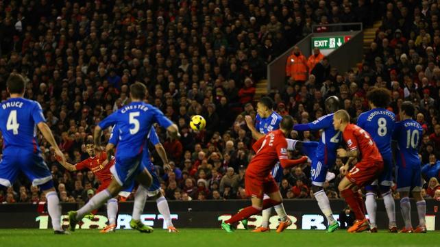 Luis Suarez scores from a free kick