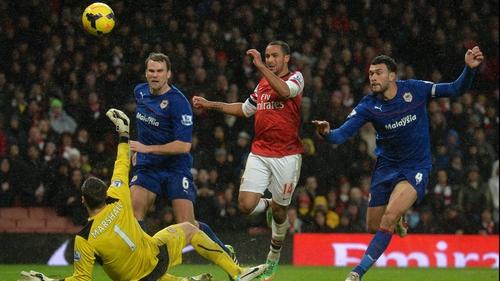 Theo Walcott beats Cardiff keeper David Marshall for Arsenal's second goal