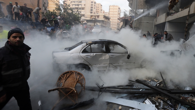 Smoke rises from burning cars at the site of a car bomb that targeted Beirut's southern suburb of Haret Hreik