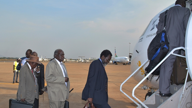 Members of South Sudan's government board a flight bound for Addis Ababa