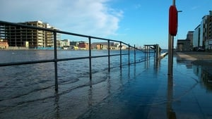 The River Liffey burst its bank near Grand Canal Dock (Pic: Claire McKeever)
