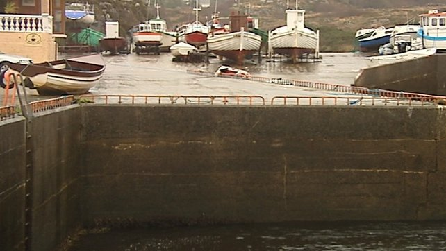 A boat (l) swept onto the pier in Bunbeg, Gweedore, Co Donegal